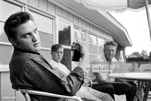 Alfred Wertheimer/Getty Images American musician Elvis Presley sits with his cousin Bobby Smith and Vernon Elvis Presley on the patio of the recently...