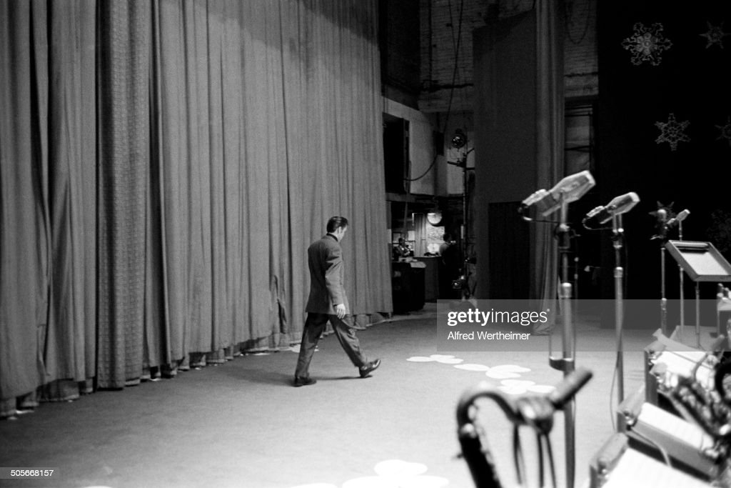 Alfred Wertheimer/Getty Images American musician Elvis Presley walks across the stage at CBSTV's Studio 50 during the rehearsal for his appearance on...