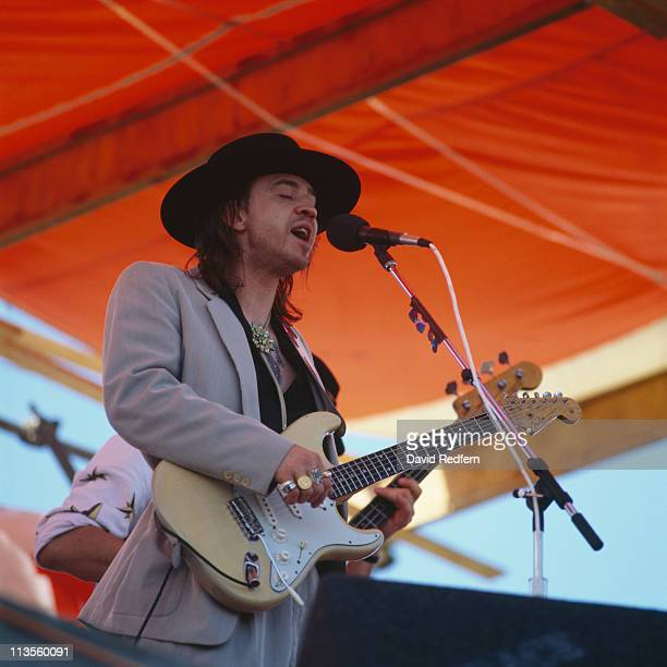 Stevie Ray Vaughan US blues guitarist playing the guitar during a live concert performance at the New Orleans Jazz and Heritage Festival in New...