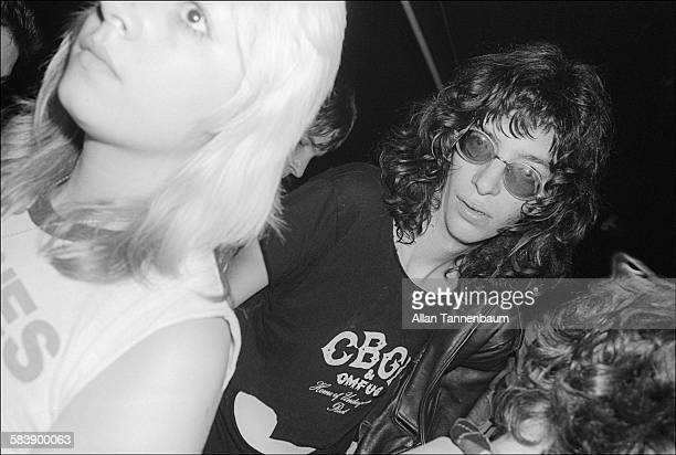 American musician Joey Ramone of the group the Ramones in a CBGB tshirt as he stands outside the club after a gig New York New York October 30 1977