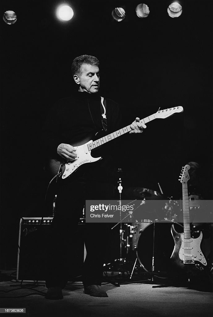 American musician Johnny Rivers (born John Henry Ramistella) plays guitar on stage, Paso Robles, California, 2009.