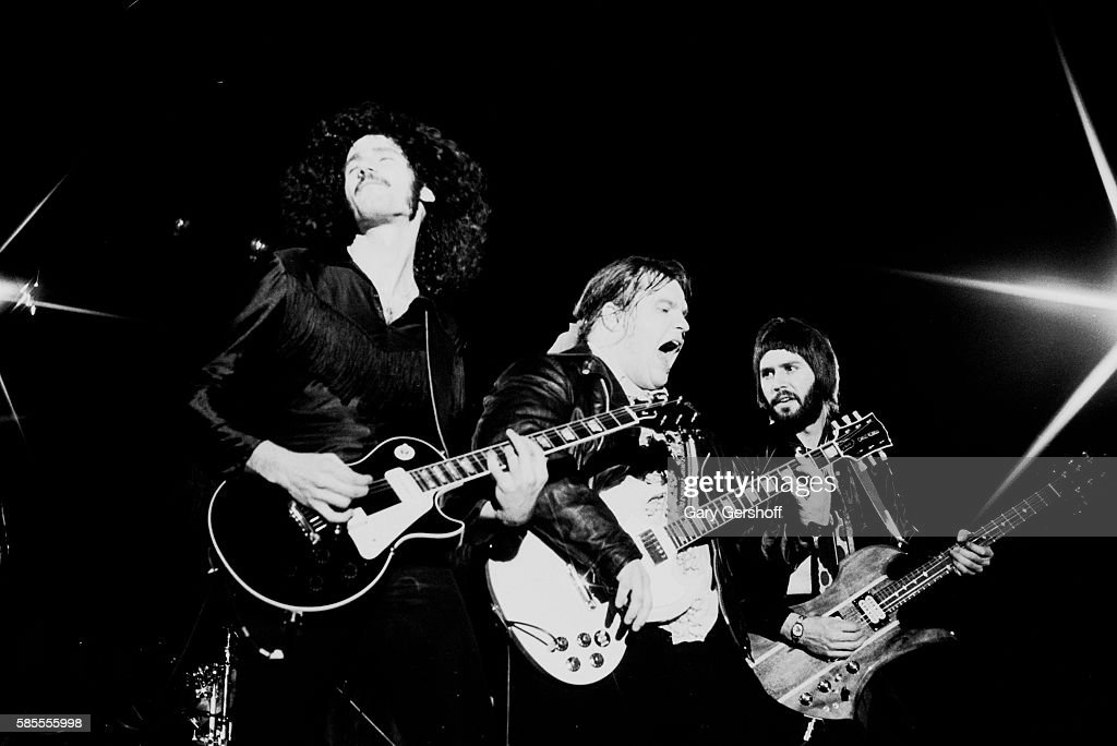 American musician Meat Loaf performs onstage with his band Neverland Express who include sibling guitarists Bruce and Bob Kulick during a performance...