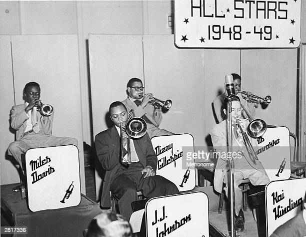 American musician Mile Davis plays the trumpet at a concert with fellow musicians Dizzy Gillespie Fats Navarro JJ Johnson and Kai Winding 1949
