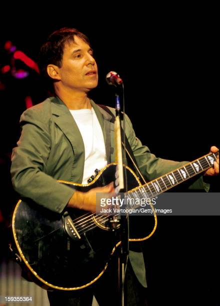 American musician Paul Simon plays guitar during the tour in support of his 'Graceland' album on stage at the Jones Beach Theatre Wantagh New York...
