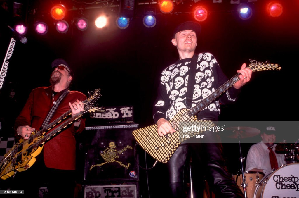 American musician Rick Nielsen of the band Cheap Trick performs with special guest Billy Corgan of Smashing Pumpkins onstage at the Metro auditorium...