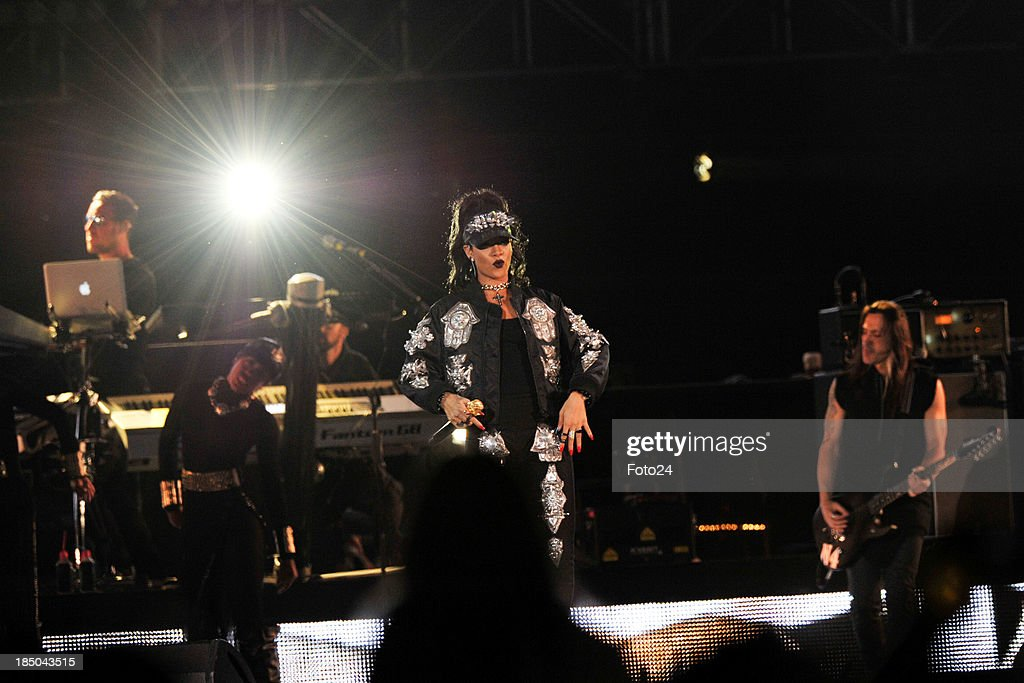 American musician <a gi-track='captionPersonalityLinkClicked' href=/galleries/search?phrase=Rihanna&family=editorial&specificpeople=453439 ng-click='$event.stopPropagation()'>Rihanna</a> performs at the FNB Stadium on October 13, 2013, in Soweto, South Africa. <a gi-track='captionPersonalityLinkClicked' href=/galleries/search?phrase=Rihanna&family=editorial&specificpeople=453439 ng-click='$event.stopPropagation()'>Rihanna</a> is currently on her Diamonds World Tour and will perform in Cape Town on October 16, 2013.