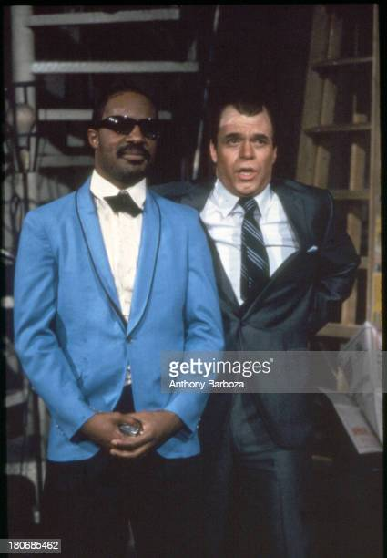 American musician Stevie Wonder and comedian Joe Piscopo perform a skit on an episode of 'Saturday Night Live' New York New York 1983