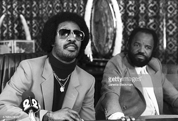 American musician Stevie Wonder and music mogul and producer Berry Gordy at an unspecified press conference Los Angeles California 1983
