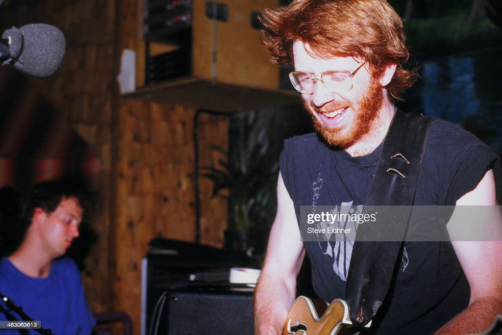 American musician Trey Anastasio, of Phish, performs at the Wetlands Preserve nightclub , New York, New York, June 9, 1990. Bandmate Page McConnell is visible in the background.