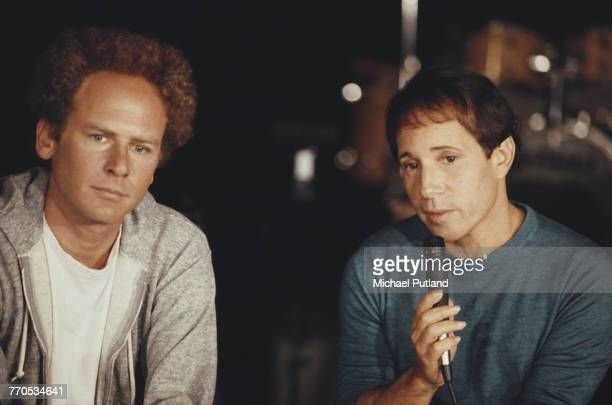 American musicians Art Garfunkel and Paul Simon of folk rock duo Simon Garfunkel pictured attending a press conference to promote their upcoming...