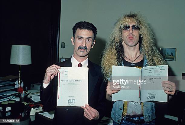 American musicians Dee Snider and Frank Zappa hold up papers relating to the PMRC senate hearing at Capitol Hill Washington DC United States 19th...