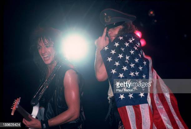 American musicians Richie Sambora and Jon Bon Jovi of the rock band Bon Jovi perform on stage Illinois early March 1987