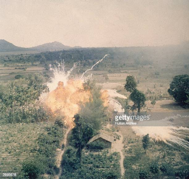 American napalm bombs exploding in fields south of Saigon during the Vietnam war Napalm kills by asphyxiation and burning and was first used by the...