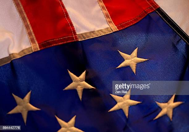 American National flag close up - selective focus on an embroidered white star