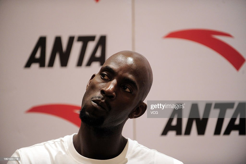American NBA player <a gi-track='captionPersonalityLinkClicked' href=/galleries/search?phrase=Kevin+Garnett&family=editorial&specificpeople=201473 ng-click='$event.stopPropagation()'>Kevin Garnett</a> of the Brooklyn Nets attends a press conference on September 8, 2013 in Guangzhou, China.