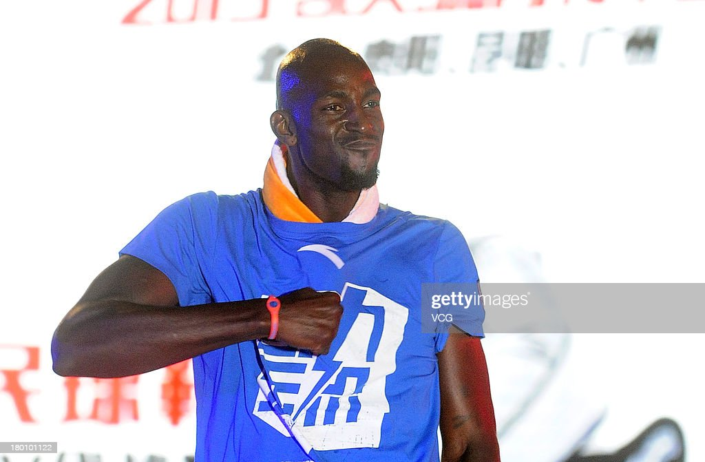 American NBA player Kevin Garnett of the Brooklyn Nets meets fans at South China Normal University on September 8, 2013 in Guangzhou, China.