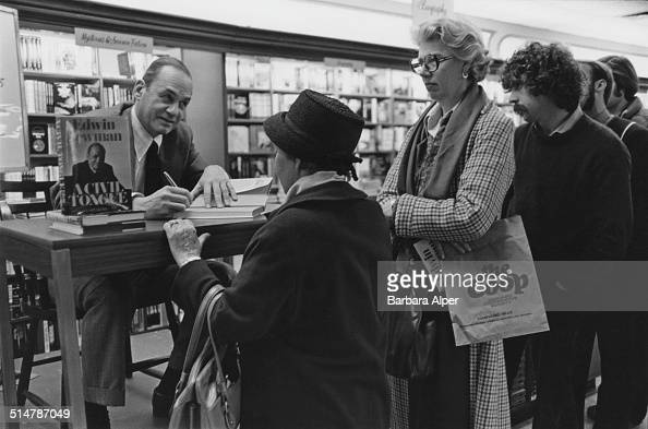 American newscaster journalist and author Edwin Harold Newman signing copies of his book 'A Civil Tongue' at 'The Coop' bookstore Cambridge...