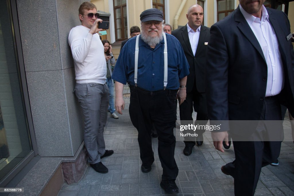 American novelist and short-story writer, screenwriter, and television producer George R. R. Martin leaves after a press conference on August 16, 2017 in Saint Petersburg, Russia