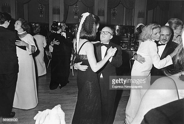 American novelist short story writer and playwright Truman Capote dances with an unidentified woman at his BlackandWhite Ball held in the Grand...