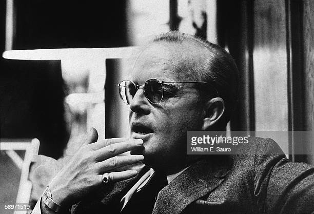 American novelist short story writer and playwright Truman Capote contemplatively touches his fingers to his chin during an interview at the Random...