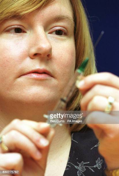 American nurse Lynda Arnold who contracted HIV as a result of a needle injury at work displays a 'safety needle' designed to prevent such occurings...