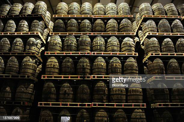 American oak barrels containing Jameson whiskey produced by Irish Distillers Ltd are seen stacked at the PernodRicard SA distillery in Middleton...