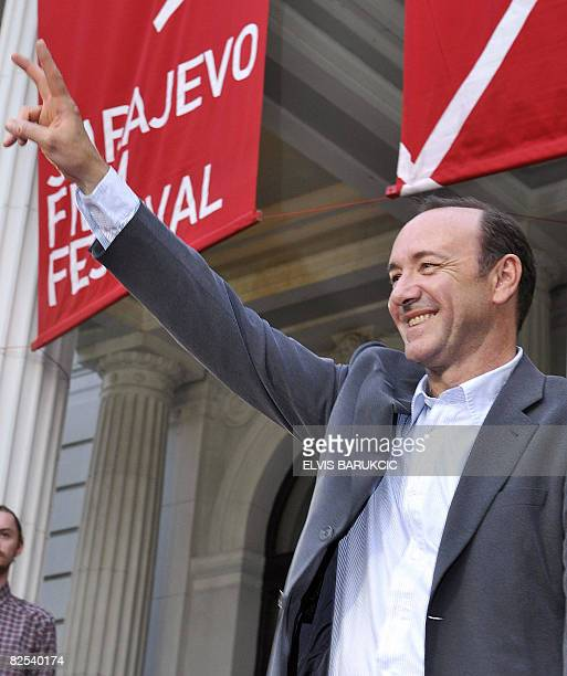 American Oscar wining actor and film director Kevin Spacey waves to a cheering crowd from the red carpet area of the Sarajevo Film Festival in...