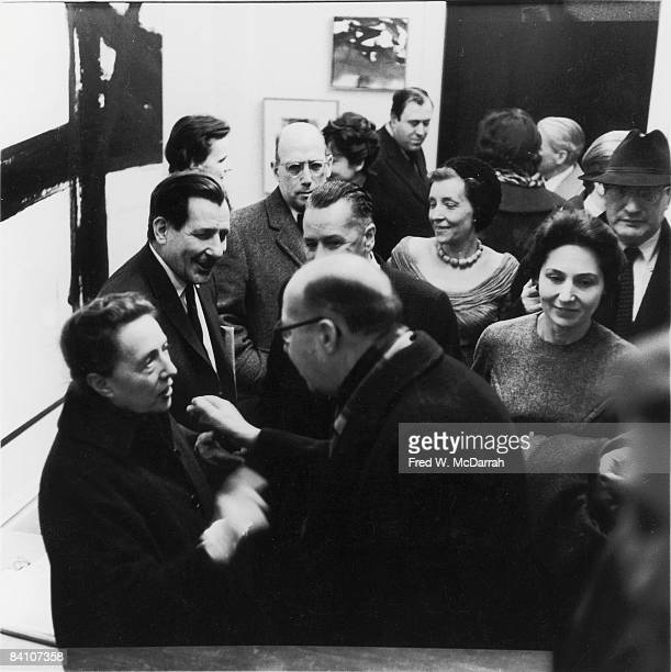 American painter Franz Kline smiles at his Sidney Janis Gallery opening New York New York March 7 1960 Among the others visible are Art collector...
