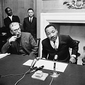 American pastor activist humanitarian and civil rights leader Martin Luther King Jr and Canon John Collins attend a press conference 6th December 1964