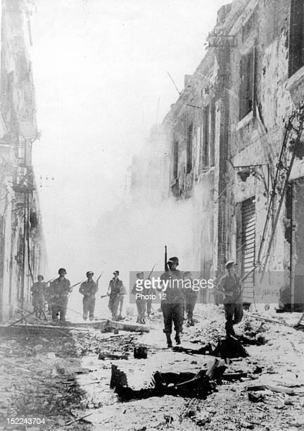 American patrols advance through smoking ruins of Messina August 24 1943