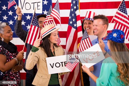 American people encourage voting. Political rally. USA flags. Vote signs.