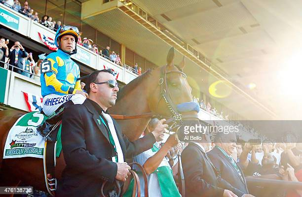American Pharoah ridden by Victor Espinoza comes out of the paddock during the 147th running of the Belmont Stakes at Belmont Park on June 6 2015 in...