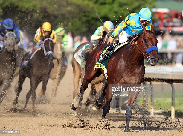 American Pharoah ridden by Victor Espinoza comes out of turn 4 during the 141st running of the Kentucky Derby at Churchill Downs on May 2 2015 in...