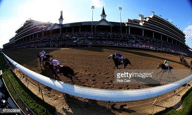 American Pharoah ridden by Victor Espinoza races Firing Line ridden by Gary Stevens to the finish line during the 141st running of the Kentucky Derby...