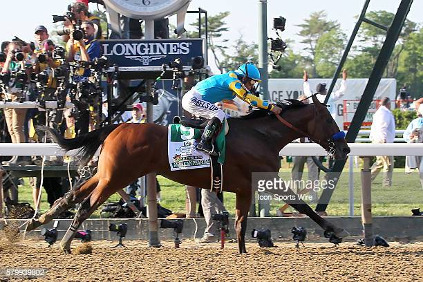 American Pharoah with jockey Victor Espinoza aboard crosses the finish line to win the 147th running of the Belmont Stakes and with it Thoroughbred...