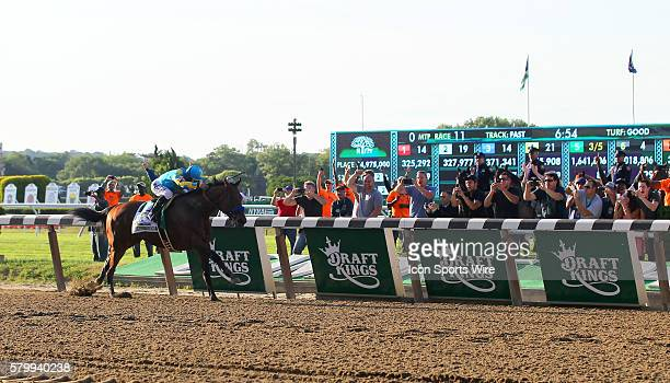 American Pharoah with jockey Victor Espinoza aboard races to the finish line to win the 147th running of the Belmont Stakes and with it Thoroughbred...