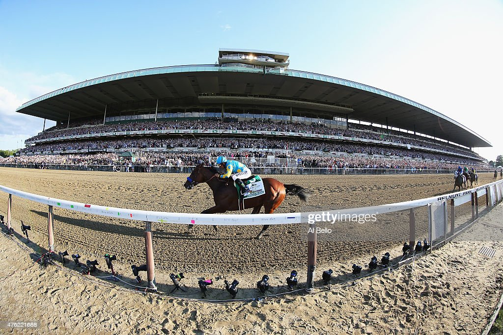 American Pharoah with Victor Espinoza up wins the 147th running of the Belmont Stakes to take the first Triple Crown in 37 years at Belmont Park on...