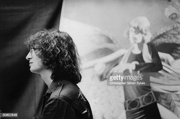 American photographer Annie Liebovitz in front of a large picture of Mick Jagger during the Rolling Stones' 1975 Tour of the Americas