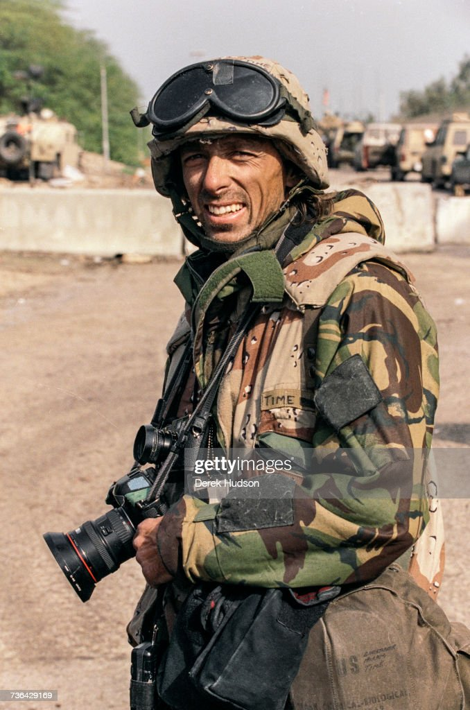 American photographer Christopher Morris photographed dressed in US military camouflage whilst covering the 1st Gulf War.