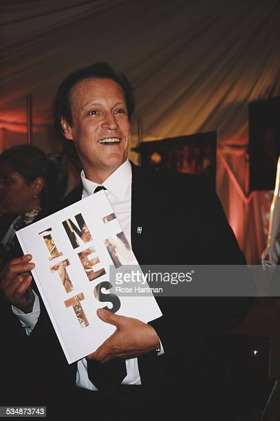 American photographer columnist and television personality Patrick McMullan at a party for the launch of his book 'InTents' New York City USA 2004
