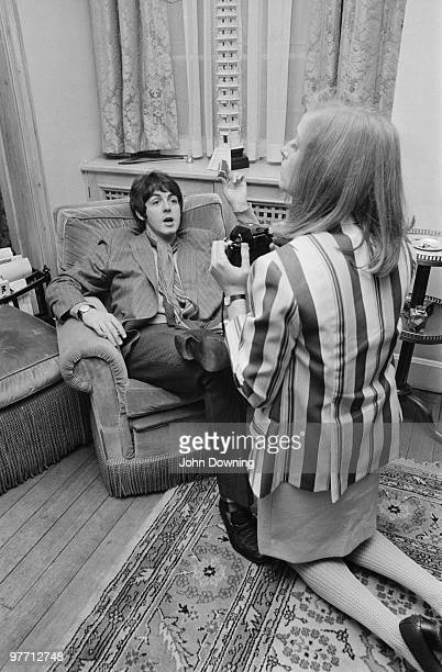 American photographer Linda Eastman takes pictures of Paul McCartney at the press launch for the Beatles' new album 'Sergeant Pepper's Lonely Hearts...