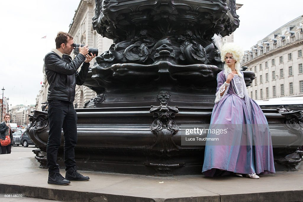 American photographer Tyler Shields takes a photo from a model launches his new exhibition at Maddox Gallery at Picadilly Circus on February 3 2016...