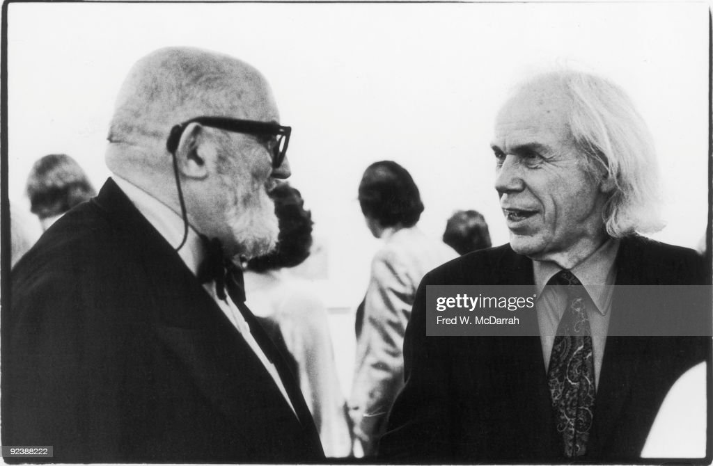 American photographers Ansel Adams (1902 - 1984) (left) and Minor White (1908 - 1976) talk at an Edward Weston exhibition at the Museum of Modern Art, New York, New York, January 27, 1975.