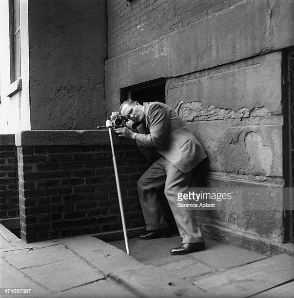 American photojournalist William Eugene Smith Demonstrates the Abbott Monopod Greenwich Village New York circa 1945