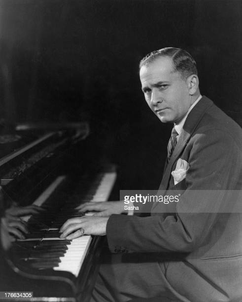 American pianist and composer Melville Gideon sitting at the piano circa 1925