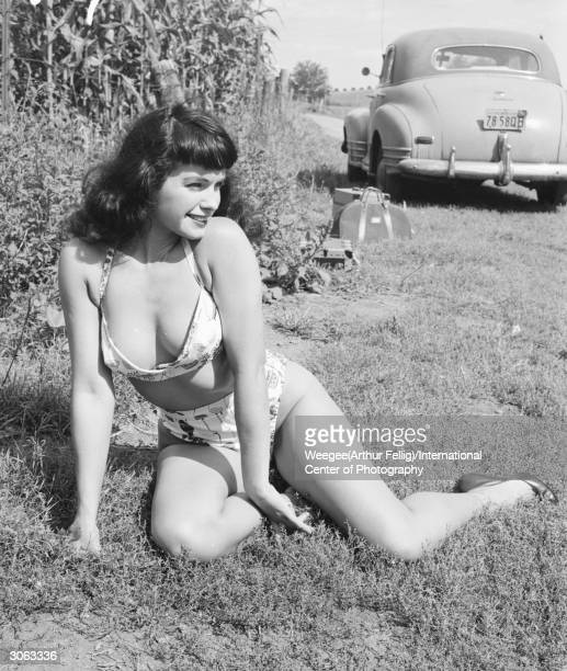 American pinup Bettie Page Playboy playmate of the month for January 1955 sunbathes in a country lane New York state 1956 Photo by...