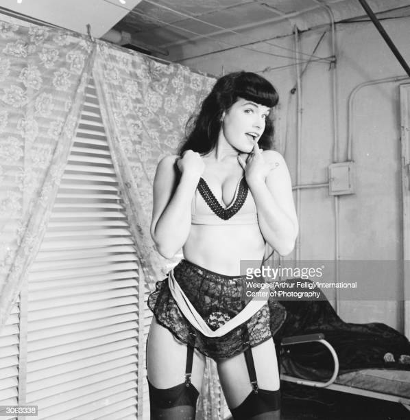 American pinup Bettie Page Playboy playmate of the month for January 1955 poses for a glamour shoot 1950s Photo by Weegee/International Center of...