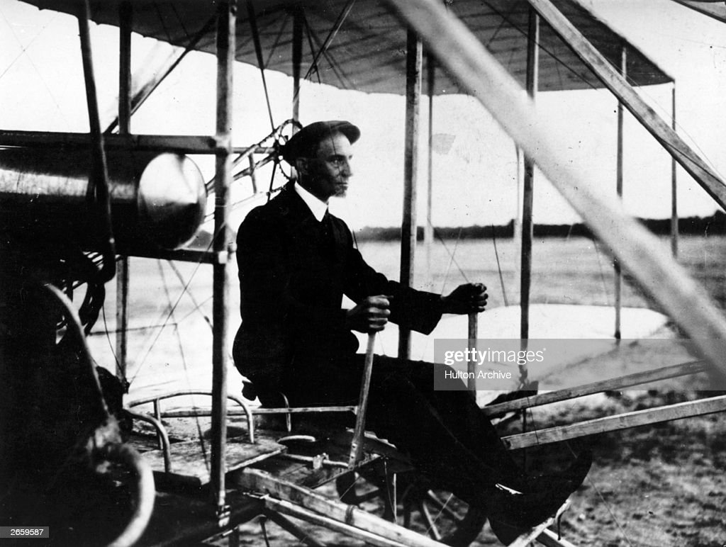 American pioneer aviator Wilbur Wright (1867 - 1912) at the controls of a plane at Auvours.