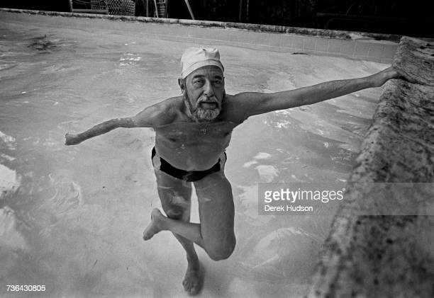 American playwright Tennessee Williams in the swimming pool at the house he owned in Key West shortly before his death