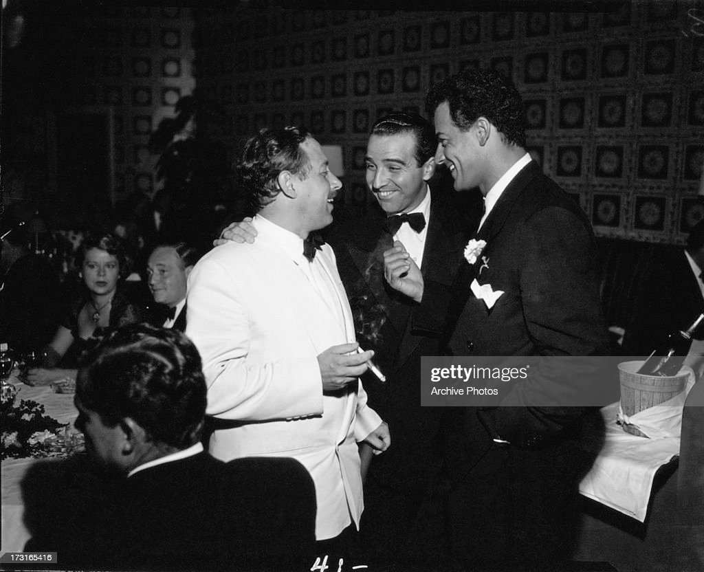 American playwright <a gi-track='captionPersonalityLinkClicked' href=/galleries/search?phrase=Tennessee+Williams&family=editorial&specificpeople=213743 ng-click='$event.stopPropagation()'>Tennessee Williams</a> (1911 - 1983, left) with actor <a gi-track='captionPersonalityLinkClicked' href=/galleries/search?phrase=Cornel+Wilde&family=editorial&specificpeople=227460 ng-click='$event.stopPropagation()'>Cornel Wilde</a> (1912 - 1989, right) at a party, Hollywood, circa 1950.